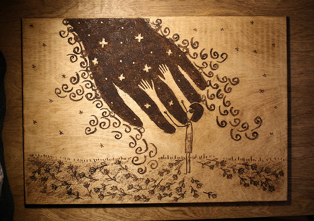 One drawing engraved on plywood. And finishing with antique wax