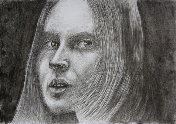 Face on the dark background. Drawing. Tauno Erik